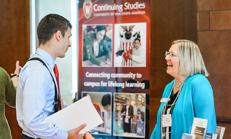 Barbara Nehls-Lowe, senior outreach specialist in the Division of Continuing Studies, talks with an attendee during the Office of Corporate Relations (OCR) Day On Campus event held in Varsity Hall in Union South at the University of Wisconsin-Madison on Aug. 23, 2017. (Photo by Bryce Richter / UW-Madison)