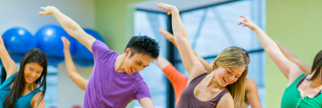 Diverse group of young adults in a modern dance class.