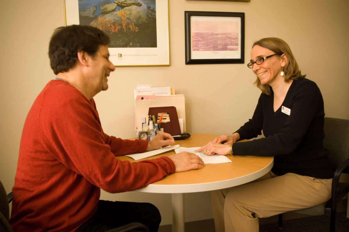 adult career services advisor meets with student