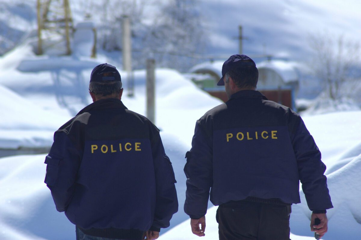 two police officers walking in snow