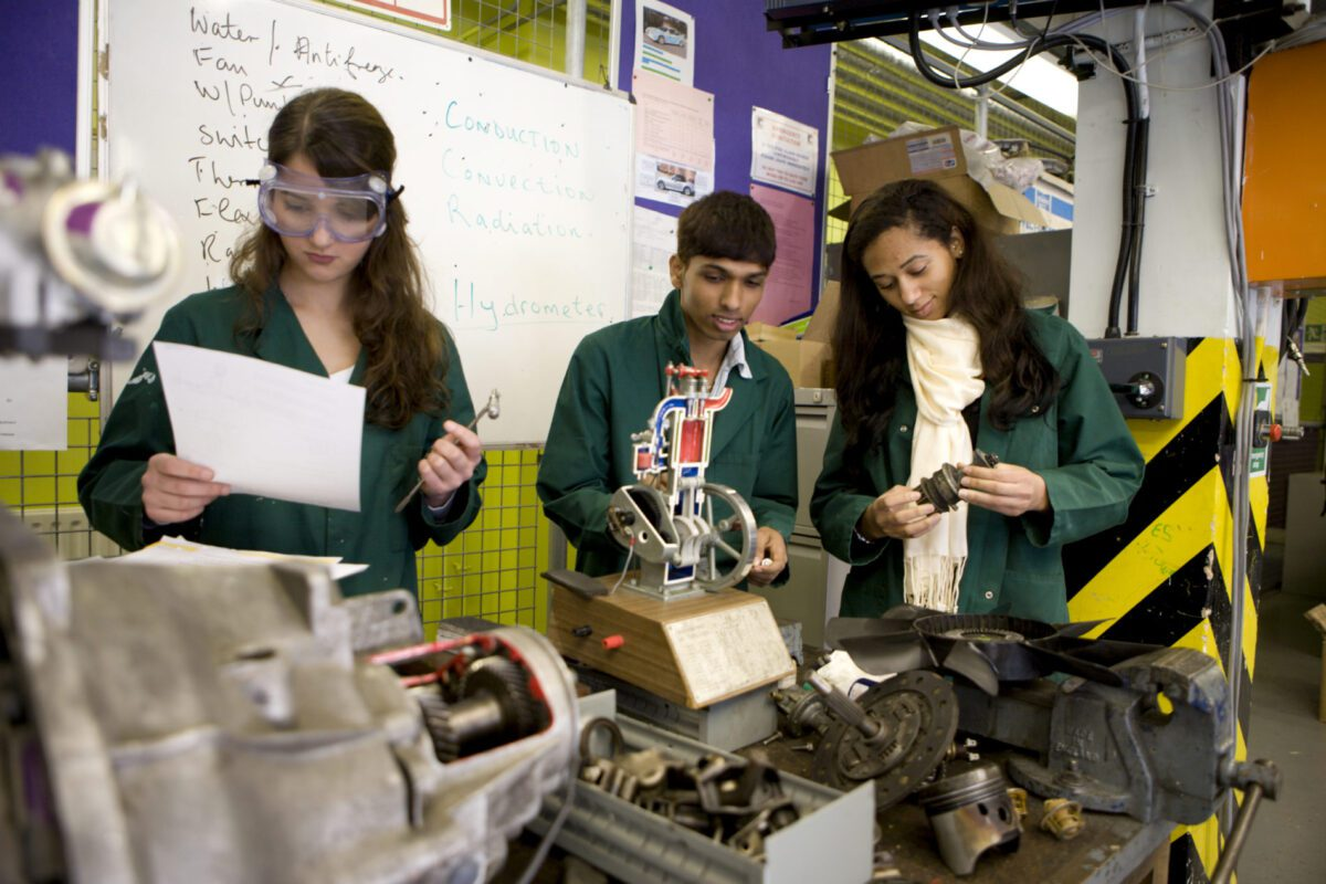 students working on an engine