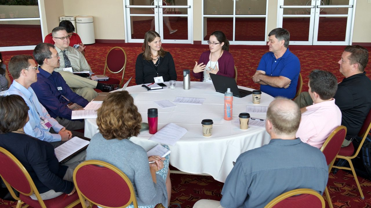 group talking at round table