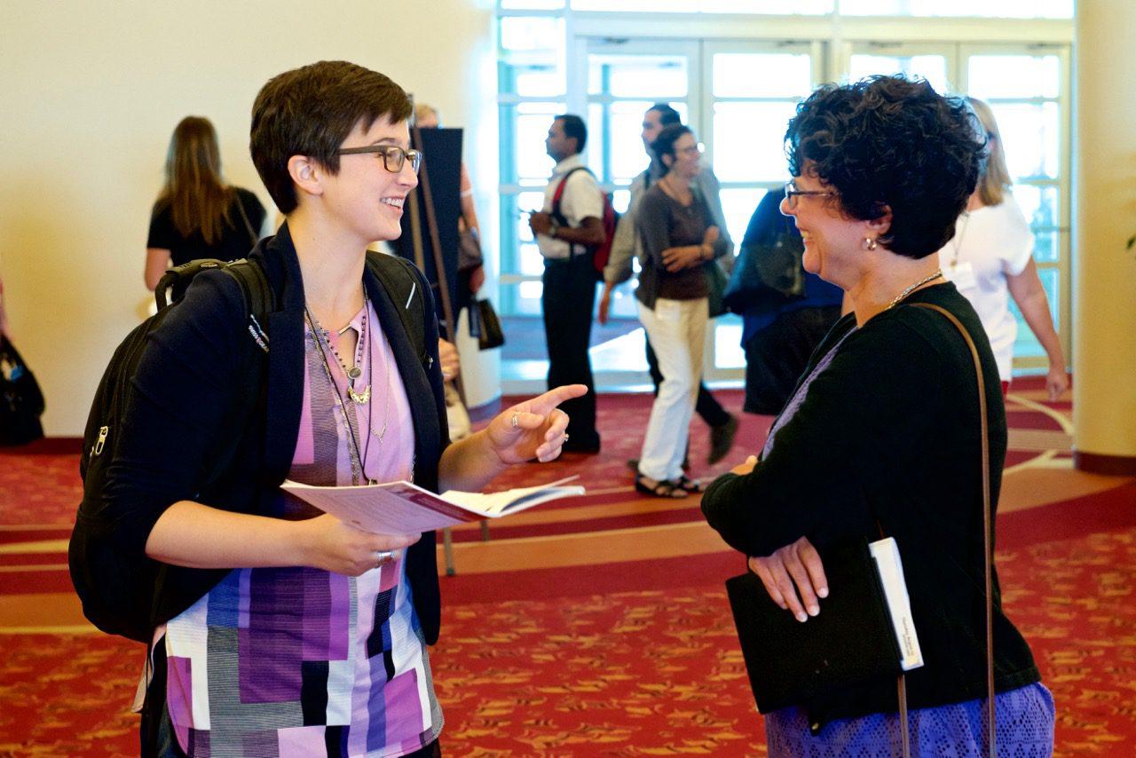 two women talking in hallway
