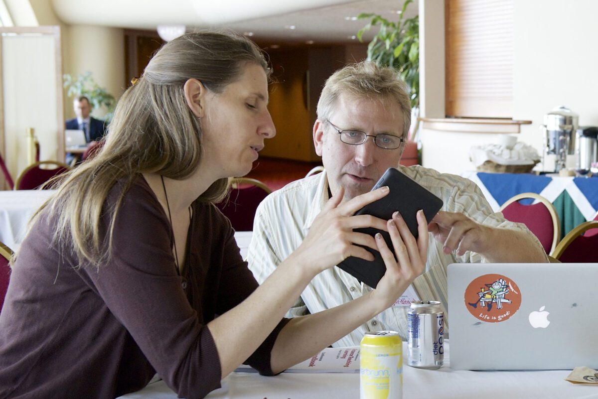 couple looking at tablet.