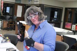 woman wearing safety goggles