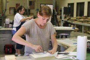 woman working on art