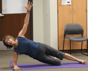 woman doing a side plank at School of the Arts at Rhinelander