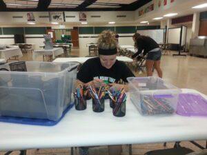 woman sorting pencils