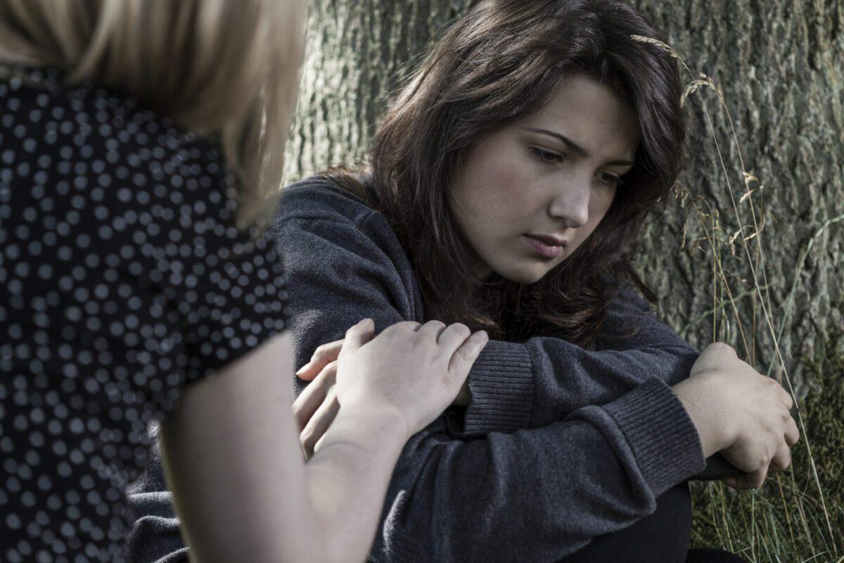 woman comforting a sad friend