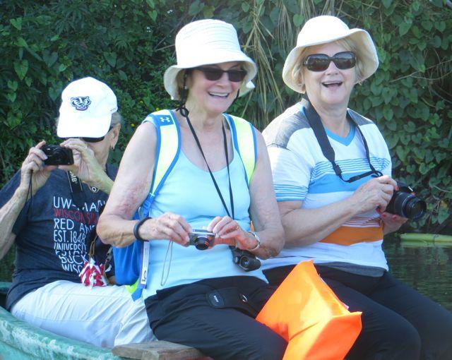 3 women birdwatching on the Toa River