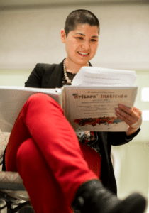 woman rading the Writers' Institute binder