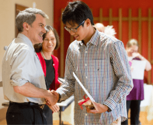 ACE student receive certificate