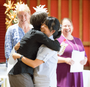 two people hug at ceremony