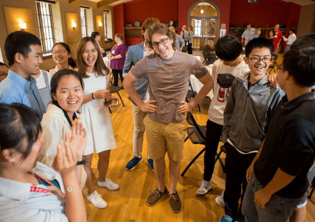 The students tease one of their counselors (center) at the closing reception.