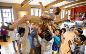 ACE students lift one student up