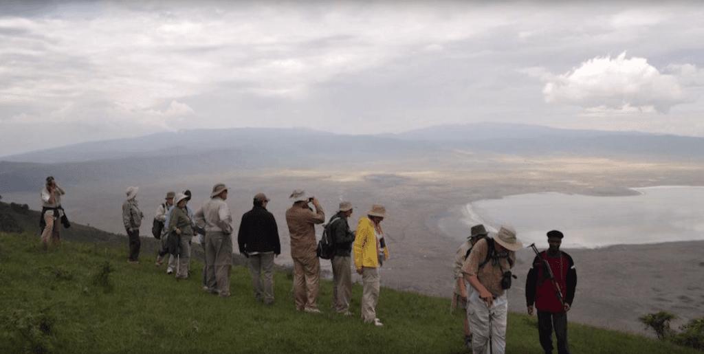Tour group overlooks an African delta