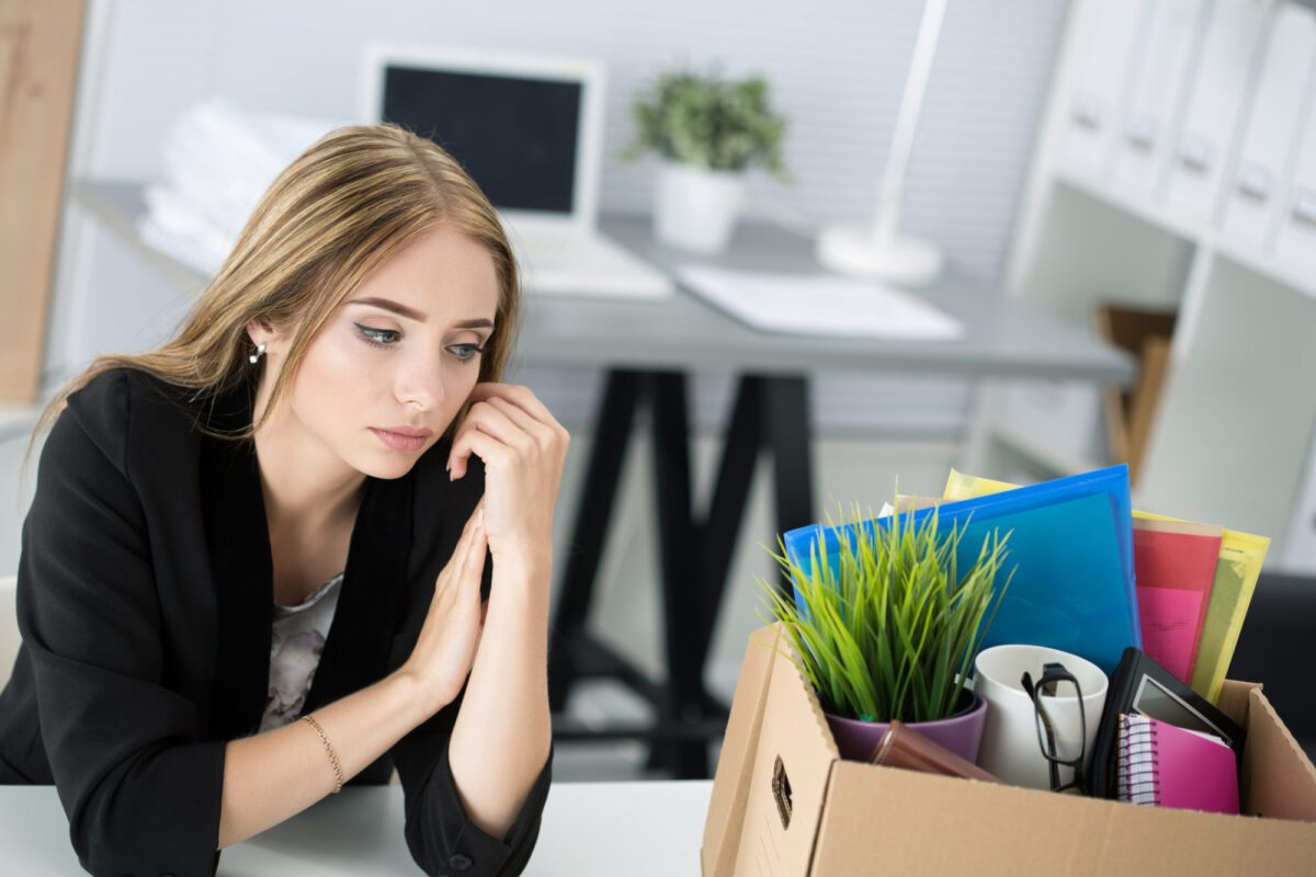 Young woman being dismissed from her job