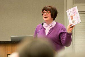 "Pat Zietlow Miller holding up the book ""Zombie in Love"""