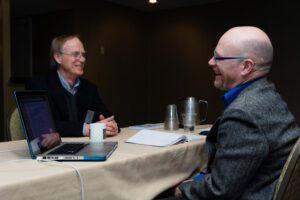 Author Norman Gilliland discusses a book idea with Mark Fretz