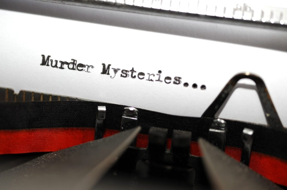 Murder Mysteries typed on paper in a typewriter