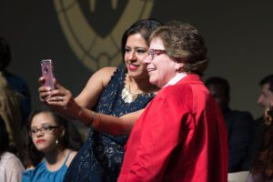 Grisel Tapia Claudio takes selfie with UW–Madison Chancellor Rebecca Blank