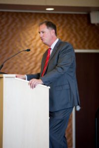 Brad Wentlandt speaking at a podium