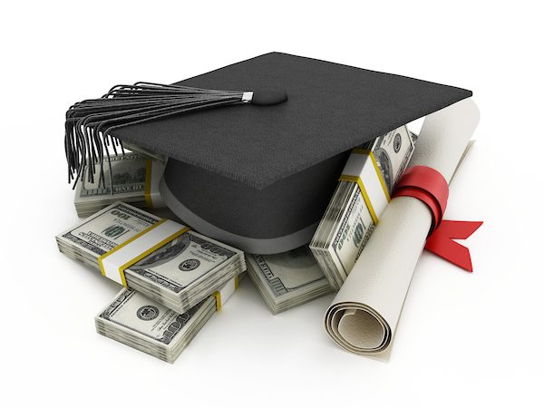 Mortarboard and diploma standing on 100 dollar bills.