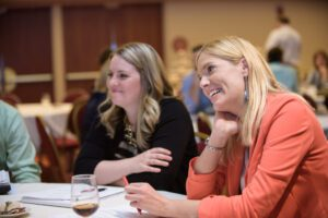 two woman participating in small group discussion