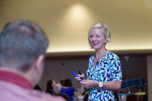 smiling woman at Rethinking Leadership Conference