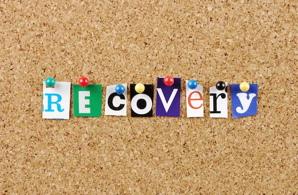 Recovery written with letter cutouts and pushpins
