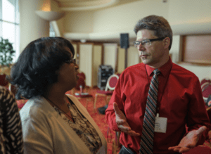 Jeff Russell talking to a Distance Teaching & Learning conference attendee