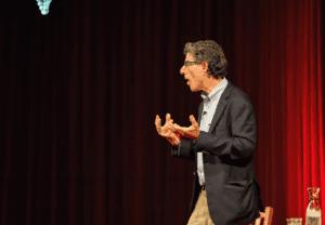 Davidson speaking on stage