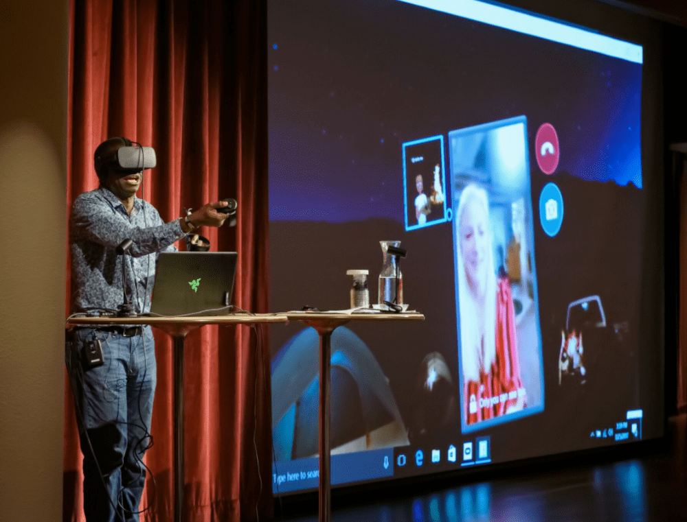 presenter controlling projector with VR glasses and remote