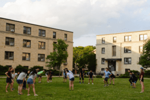 playing a game in front of the dorms