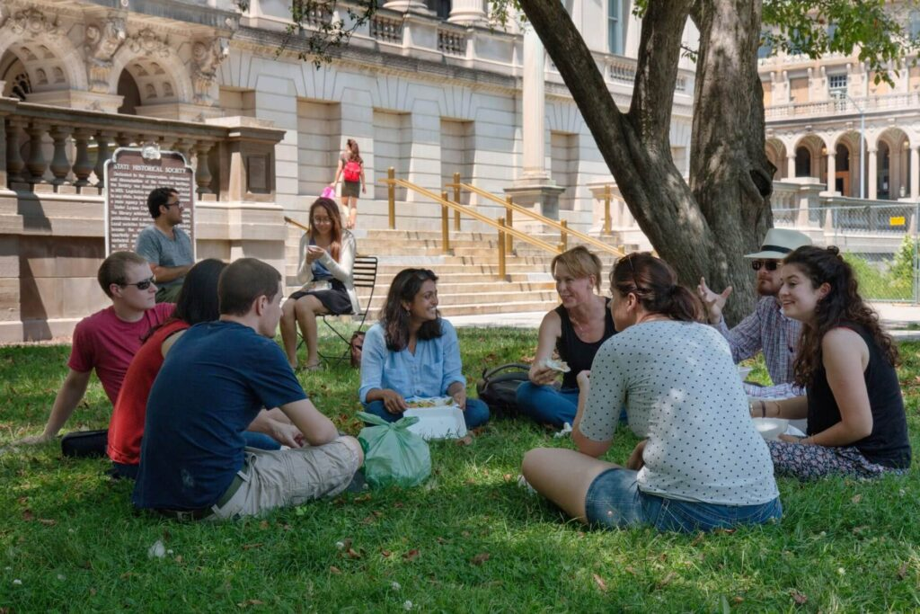 students studying on the lawn of the Wisconsin State Capitol