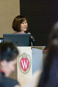 Christine Inthachith talks at podium