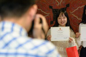 Li Yougqing poses with her ACE certificate