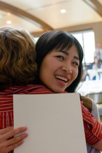 ACE students hugs instructor