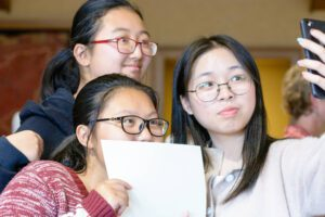 ACE students take selfie with certificate