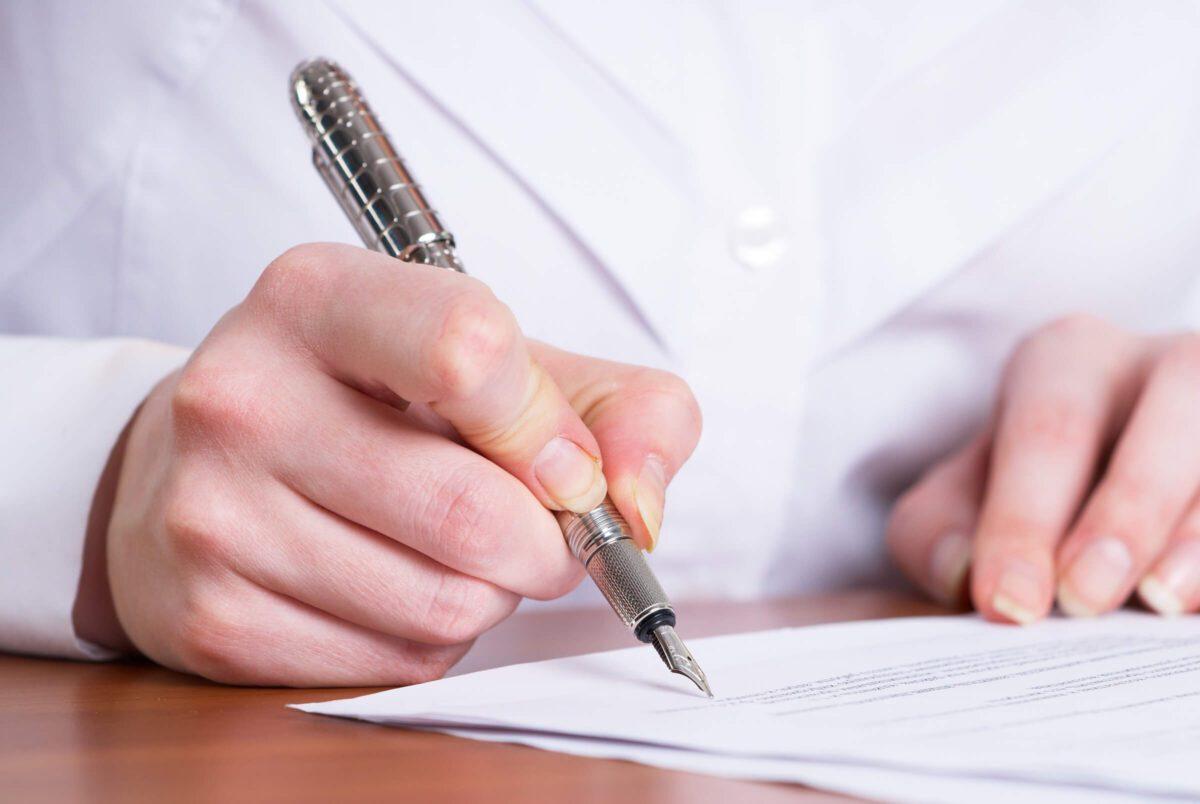 Professional woman holding pen
