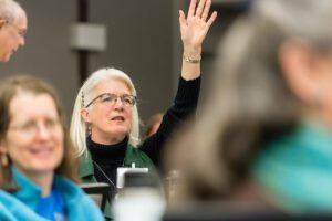 Woman raises hand