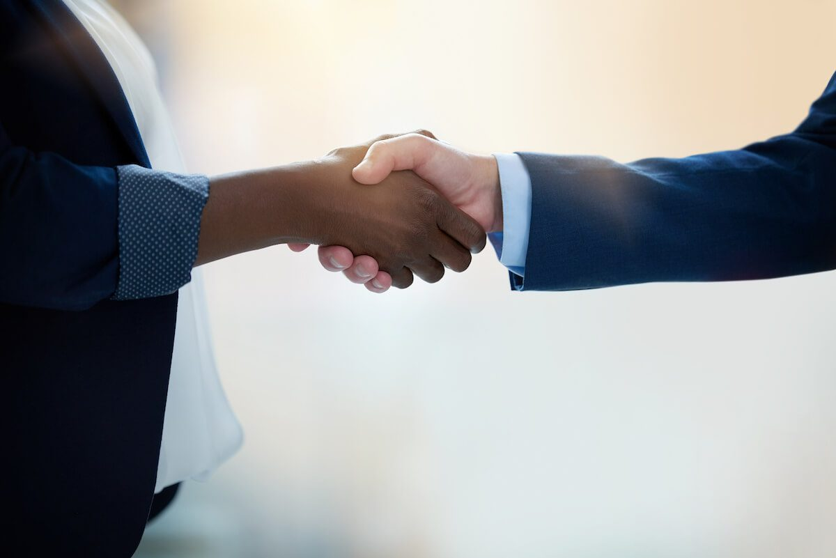 professionals shaking hands; networking