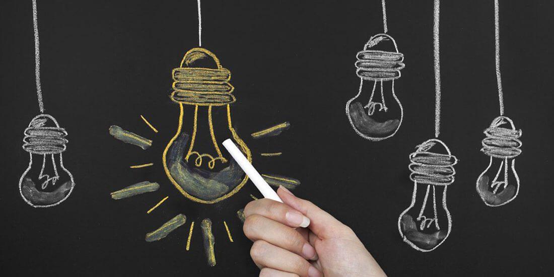 Big Idea Light Bullb on blackboard
