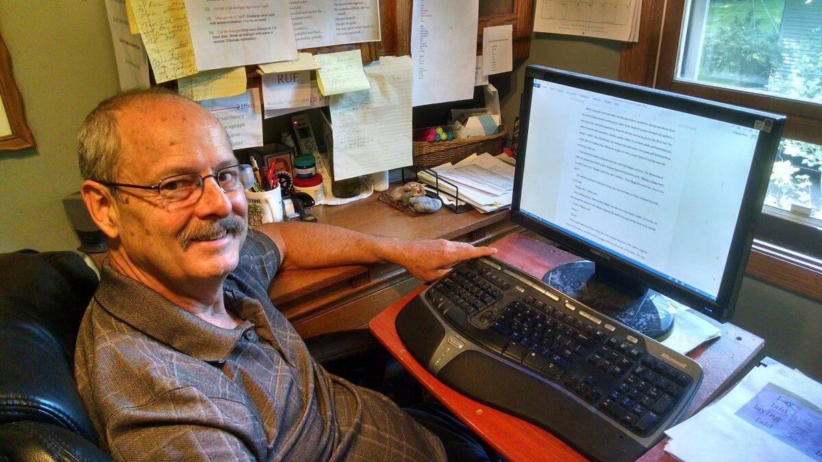 Writer Greg Renz at computer