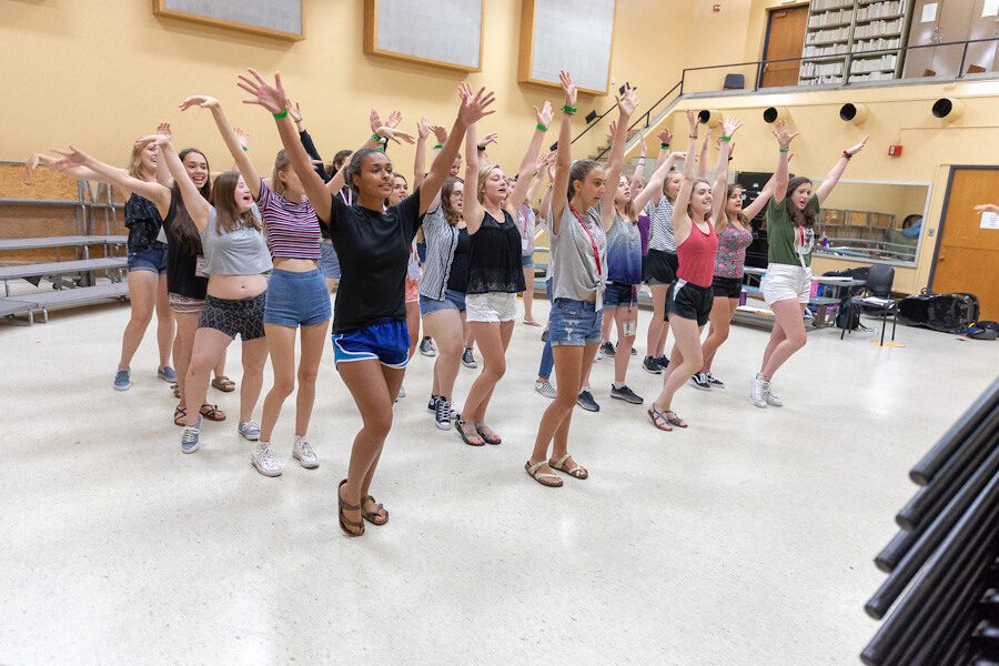 group of female students practicing theater at Summer Music Clinic
