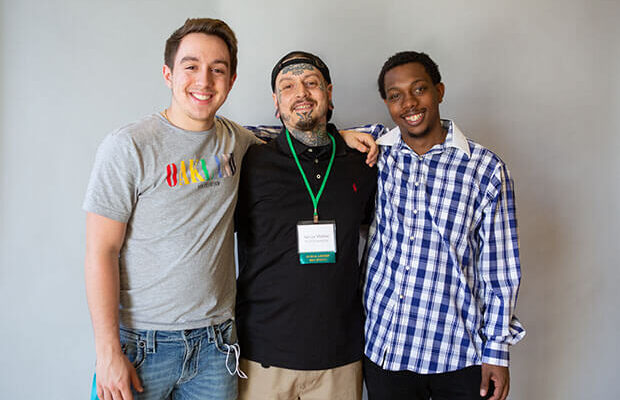 Life is full of restarts for students like Adrian Molitor (center), who faced incarceration and recovery but was supported by people who encouraged him to keep writing.