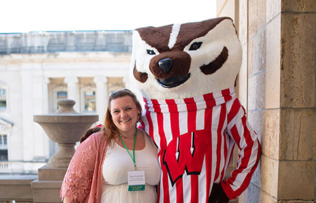 Bucky helped adult students like Kasey Kohlhardt, working on a master's in social work, celebrate their scholarships and successes.