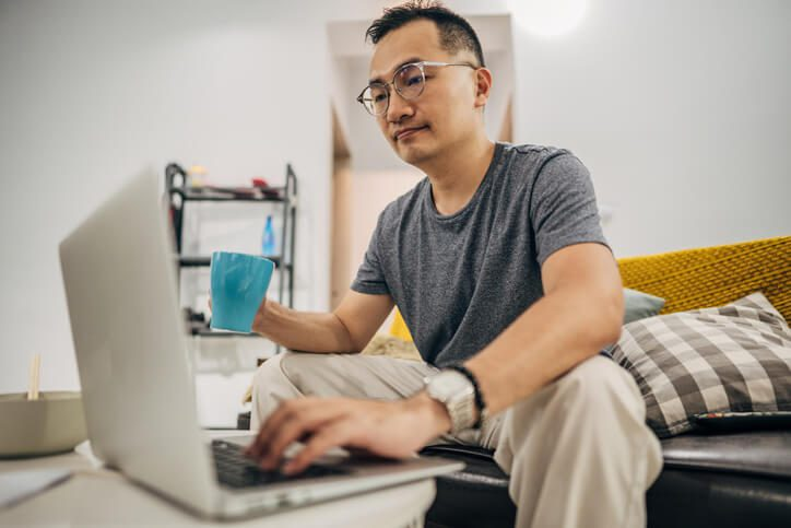 Man looking at this laptop from home