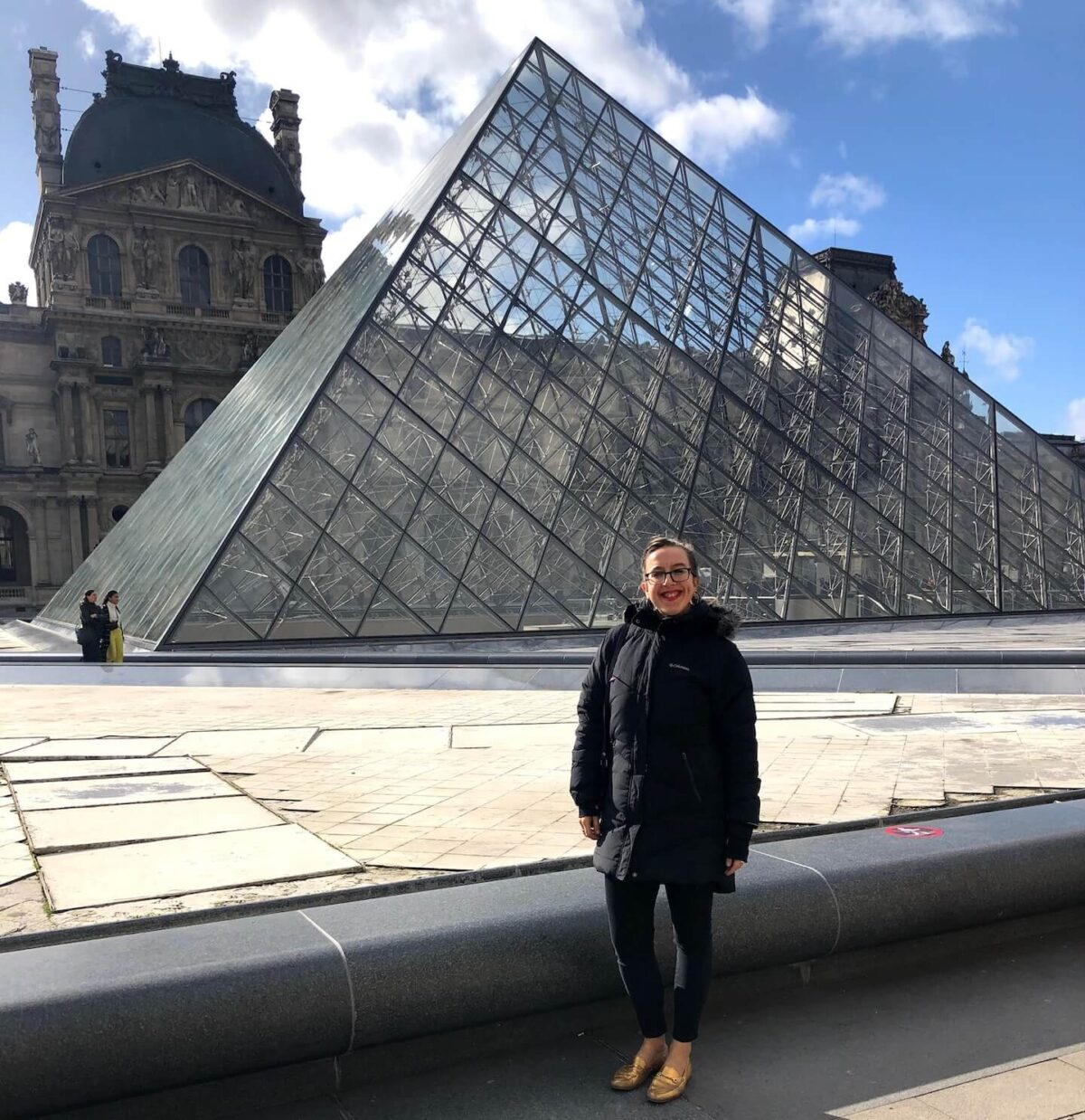 French student Sonja Whipp at the Louvre Pyramid