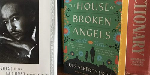 Book covers of 'The House of Broken Angels,' a dictionary and Langston Hughes.